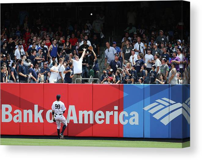 People Canvas Print featuring the photograph Domingo Santana And Aaron Judge by Al Bello
