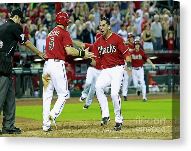 American League Baseball Canvas Print featuring the photograph Ender Inciarte, David Peralta, And Paul Goldschmidt by Ralph Freso