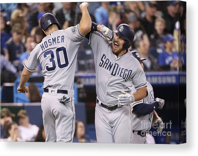 People Canvas Print featuring the photograph Eric Hosmer And Hunter Renfroe by Tom Szczerbowski