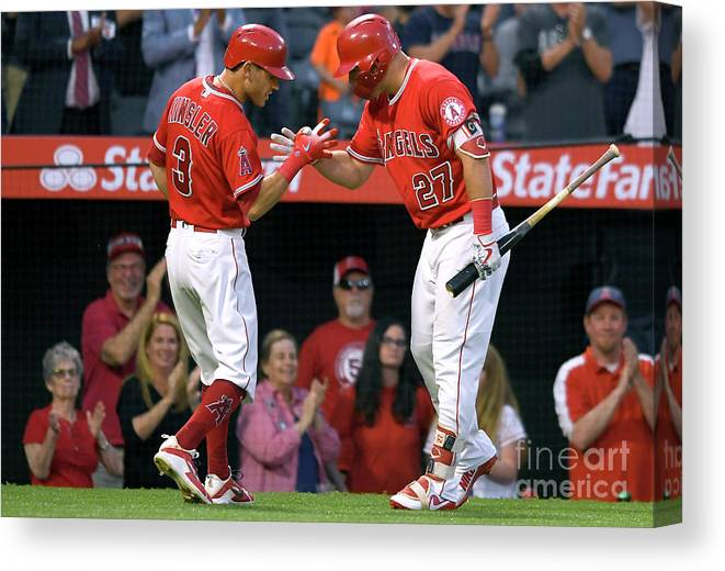 People Canvas Print featuring the photograph Ian Kinsler And Mike Trout by John Mccoy