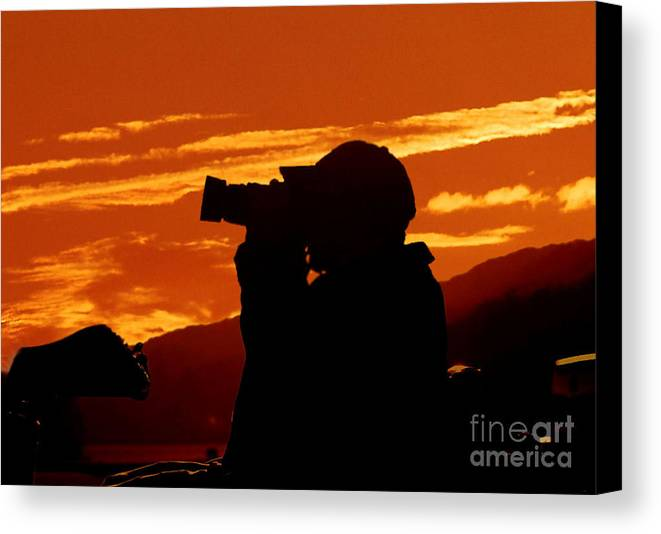 Sunset Canvas Print featuring the photograph A Photographer Enjoying His Work by Kathy Baccari