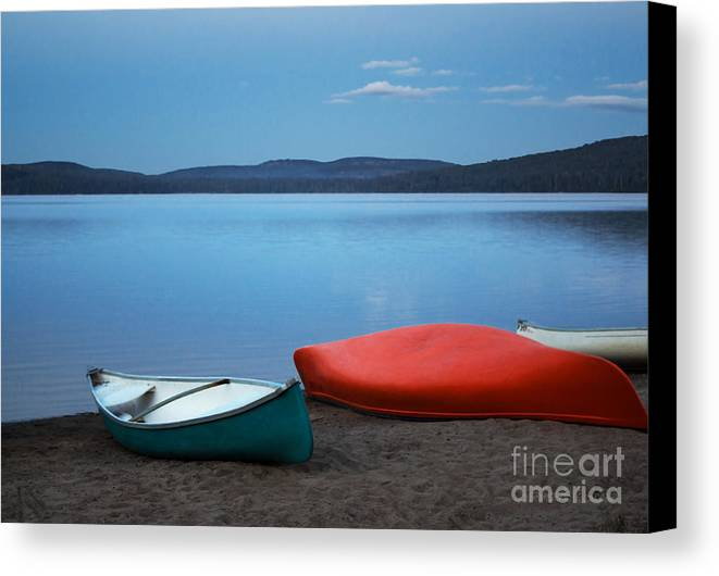 Canoe Canvas Print featuring the photograph Paddle's End by Barbara McMahon