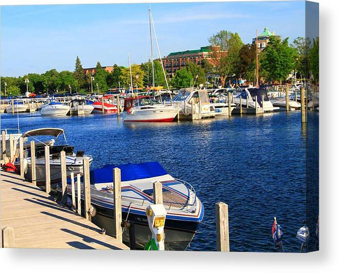 Boat Canvas Print featuring the photograph Boats On The Dock Traverse City by Dan Sproul