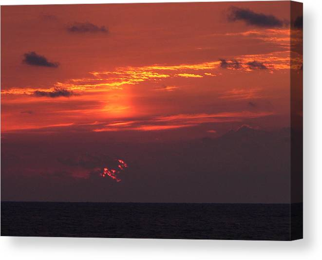 Sun Canvas Print featuring the photograph Sunrising Out Of Clouds by Tom LoPresti