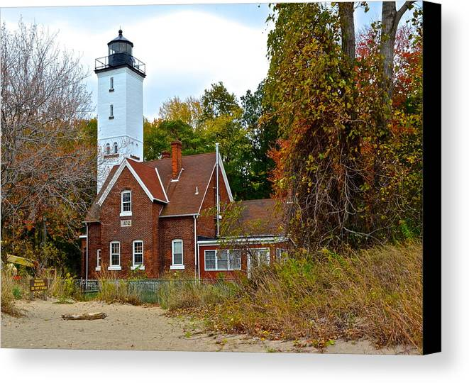 Presque Canvas Print featuring the photograph Presque Isle Lighthouse by Frozen in Time Fine Art Photography