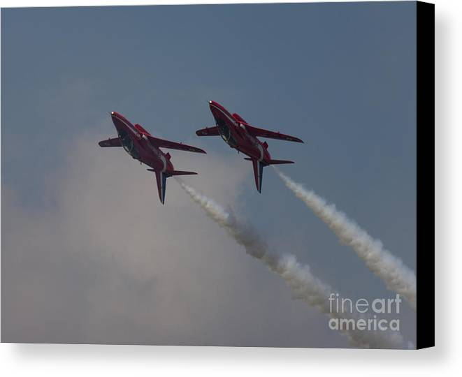 Red Arrows Canvas Print featuring the photograph Two Red Arrows by Philip Pound