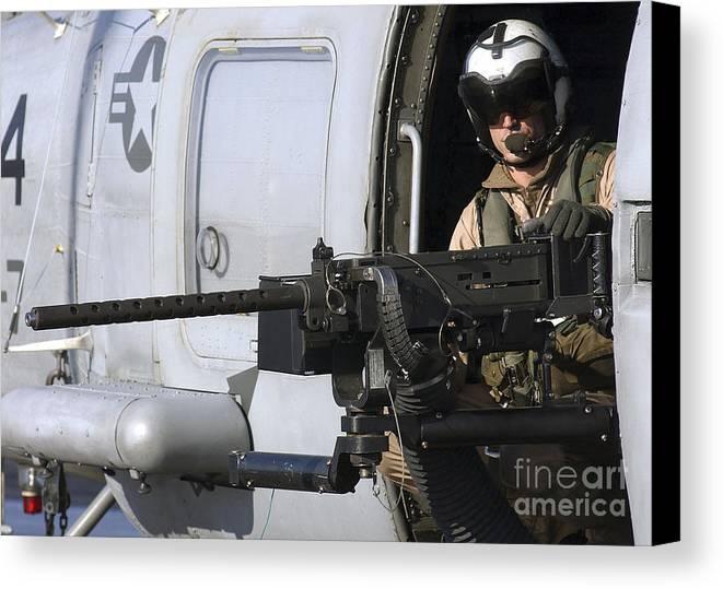 Door Gunner Canvas Print featuring the photograph Soldier Mans A .50 Caliber Machine Gun by Stocktrek Images