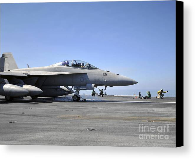 Operation Enduring Freedom Canvas Print featuring the photograph A Shooter Signals The Launch Of An by Stocktrek Images