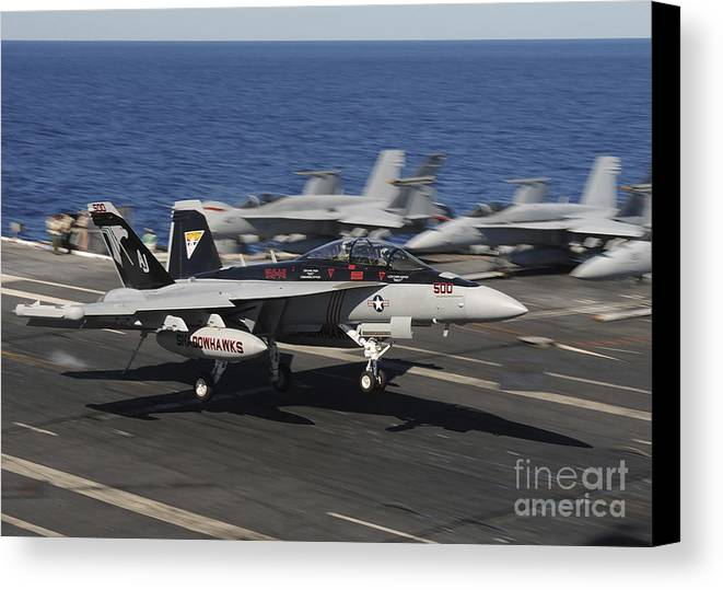 Ea-18g Growler Canvas Print featuring the photograph An Ea-18g Growler Lands Aboard Uss by Stocktrek Images