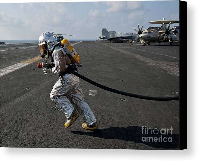 Operation Enduring Freedom Canvas Print featuring the photograph Aviation Boatswain's Mate Carries by Stocktrek Images