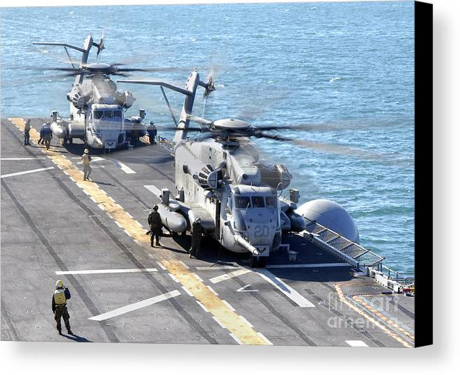 Warship Canvas Print featuring the photograph Ch-53e Super Stallion Helicopters by Stocktrek Images
