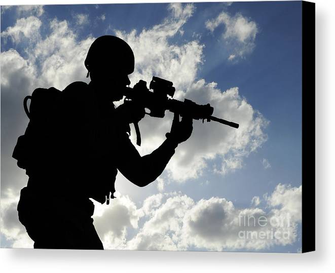 Security Operations Canvas Print featuring the photograph Silhouette Of A Soldier by Stocktrek Images