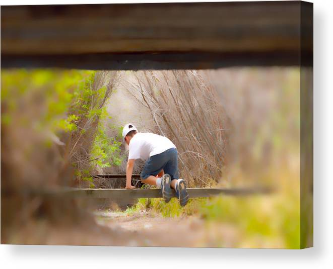 Boy Canvas Print featuring the photograph Climb On Over by Brent Dolliver