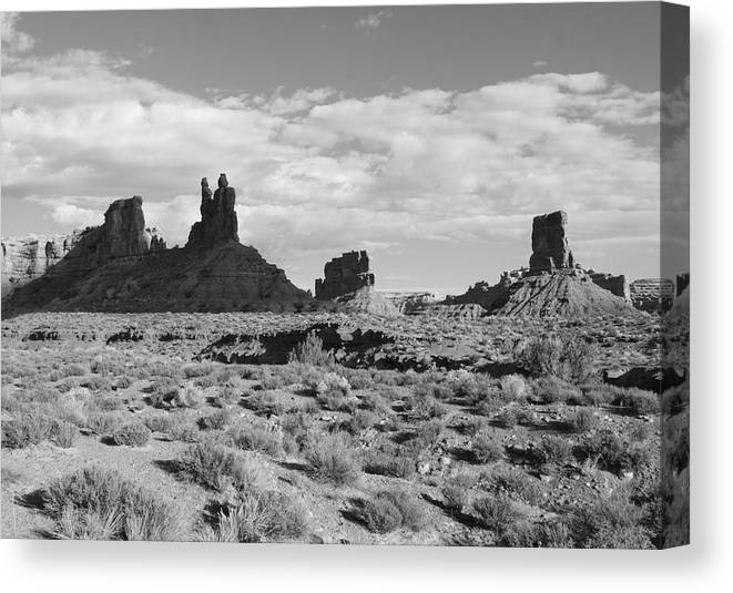 Black And White Canvas Print featuring the photograph Valley Of The Gods by Troy Montemayor