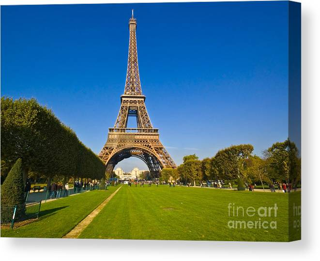 Canvas Print featuring the photograph Eiffel Tower by Charuhas Images
