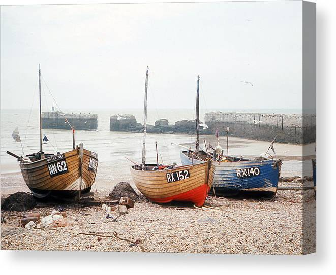 Hastings Canvas Print featuring the photograph Hastings England Beached Fishing Boats by Richard Singleton