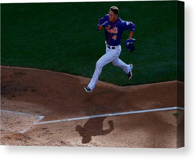 Game Two Canvas Print featuring the photograph Daisuke Matsuzaka And Wilmer Flores by Mike Stobe