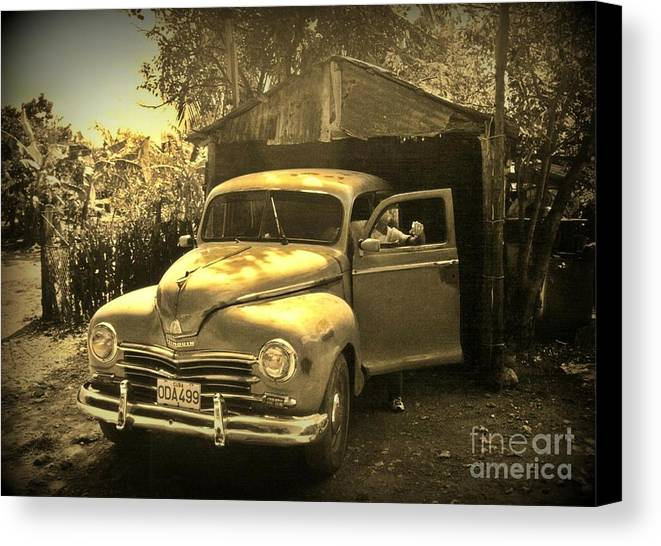Antique Cars Canvas Print featuring the photograph An Old Hidden Gem by John Malone
