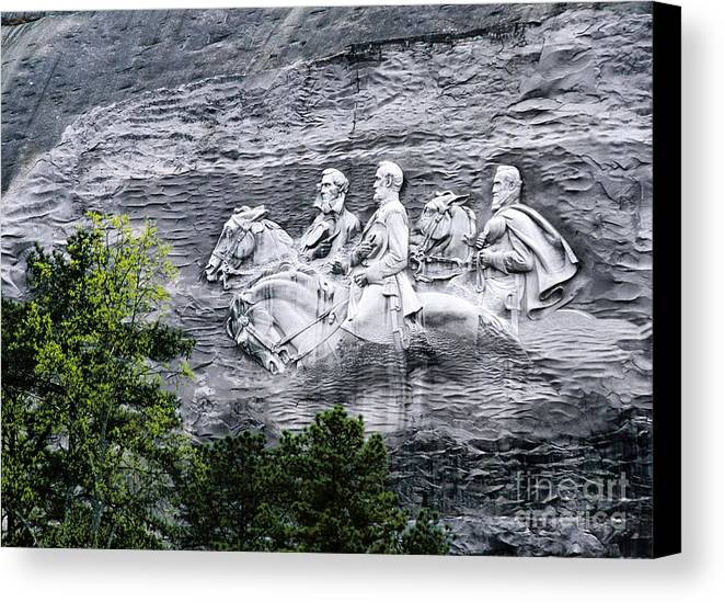 Confederate Canvas Print featuring the photograph Confederate Generals Davis Lee And Jackson Rock Carving Stone Mountain Park Atlanta Georgia Usa by David Lyons