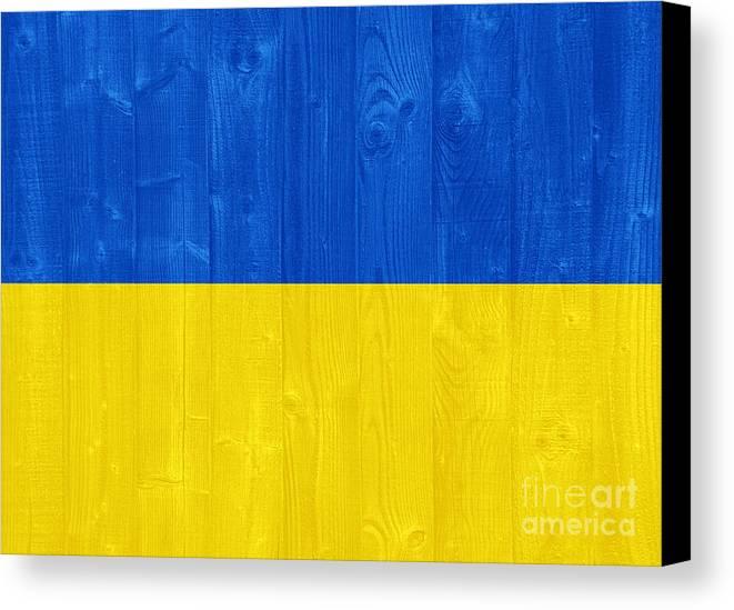Ukraine Canvas Print featuring the photograph Ukraine Flag by Luis Alvarenga