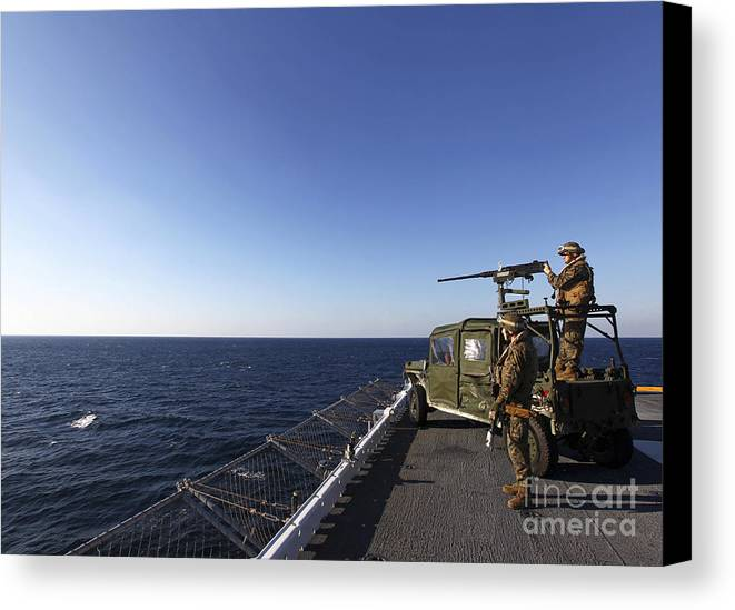 Soldier Canvas Print featuring the photograph Marines Provide Defense Security by Stocktrek Images