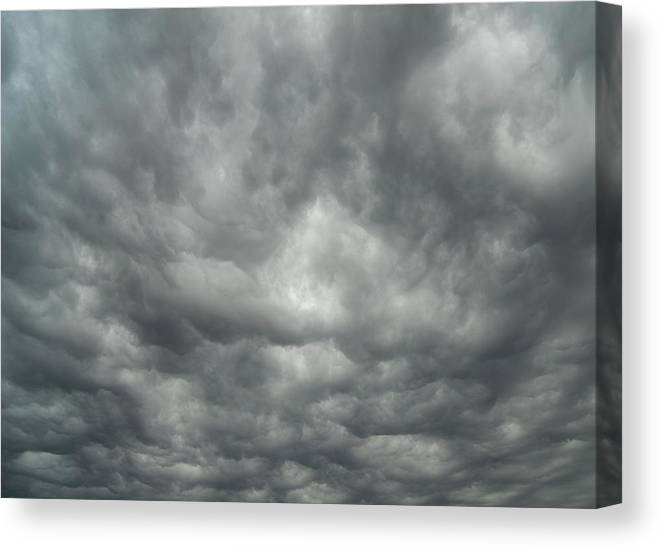 Clouds Canvas Print featuring the photograph Eerie by Coleen Harty