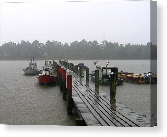 Boat Canvas Print featuring the photograph Gettin' Wet by Rick McKinney