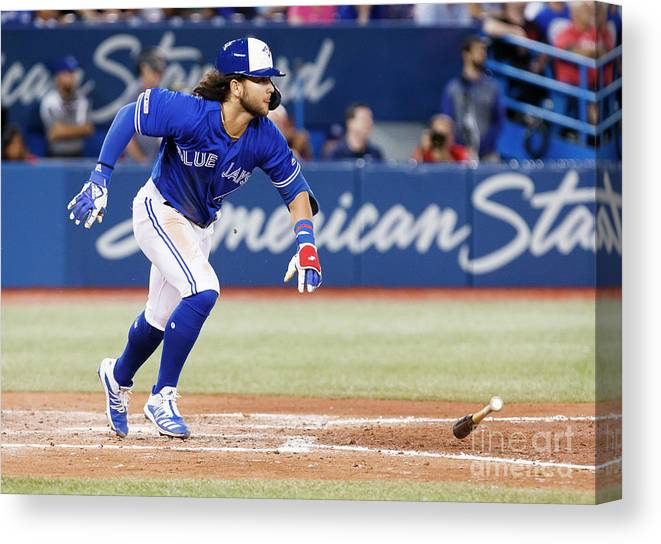 People Canvas Print featuring the photograph New York Yankees V Toronto Blue Jays by Mark Blinch