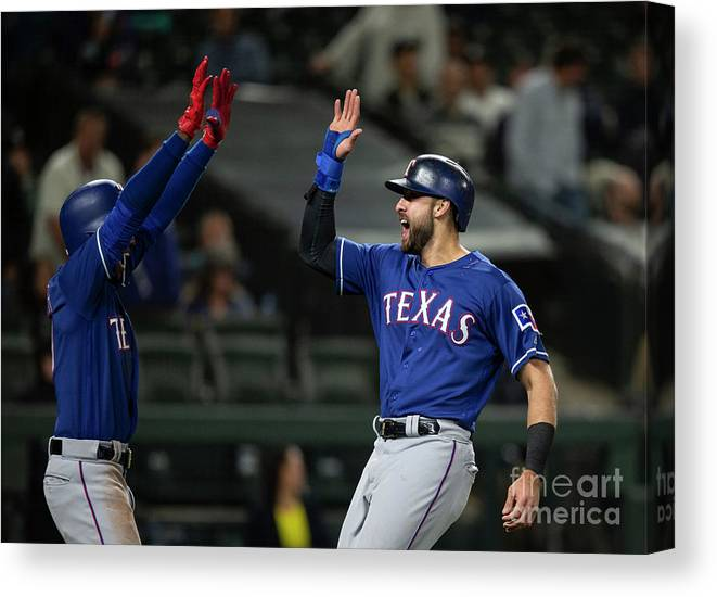 Three Quarter Length Canvas Print featuring the photograph Texas Rangers V Seattle Mariners by Stephen Brashear