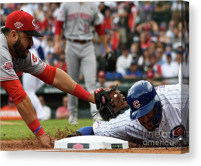 People Canvas Print featuring the photograph Kris Bryant And Eugenio Suarez by David Banks
