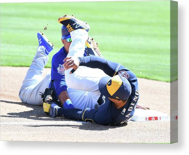 People Canvas Print featuring the photograph Willson Contreras And Tyler Saladino by Norm Hall