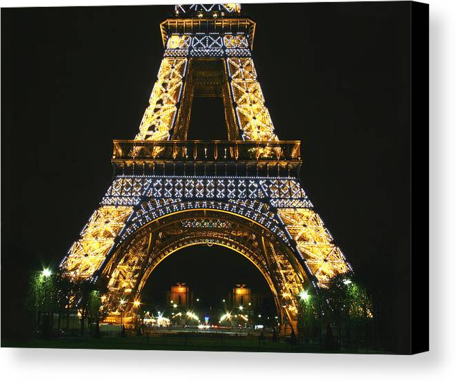 Eiffel Tower Canvas Print featuring the photograph Eiffel Tower At Night by Hans Jankowski