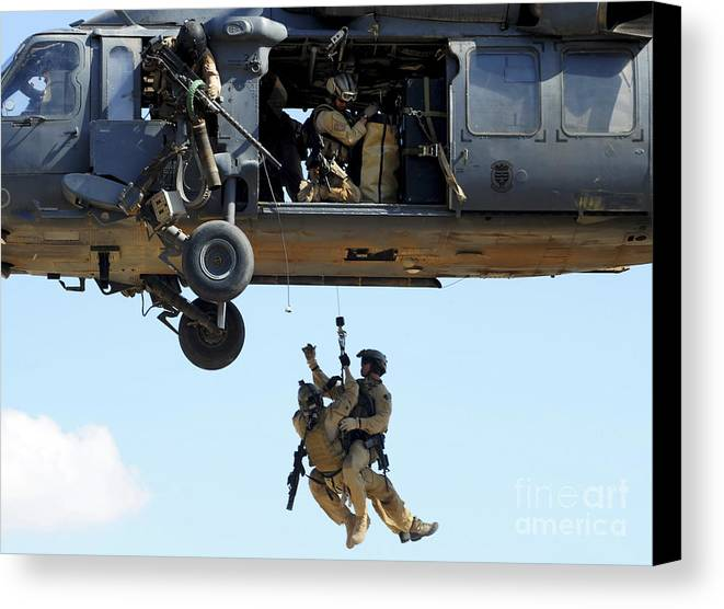 Csar Canvas Print featuring the photograph Pararescuemen Are Hoisted Into An Hh-60 by Stocktrek Images