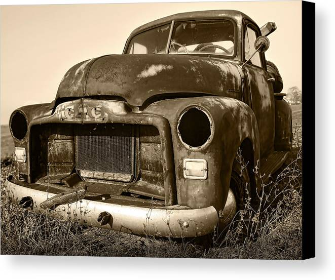 Vintage Canvas Print featuring the photograph Rusty But Trusty Old Gmc Pickup by Gordon Dean II