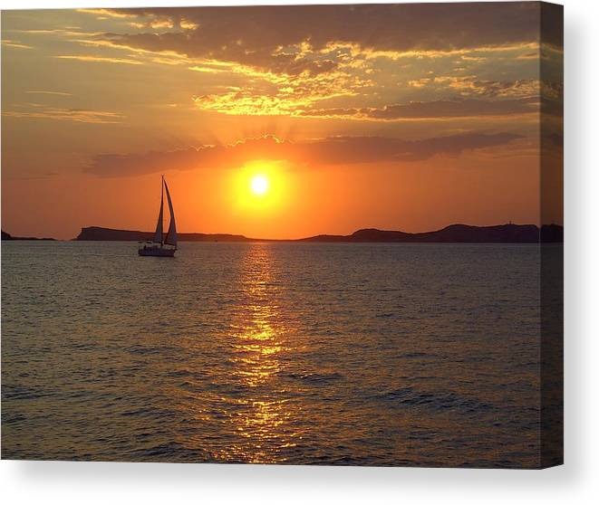 Ibiza Canvas Print featuring the photograph Sailing Boat In Ibiza Sunset by Steve Kearns