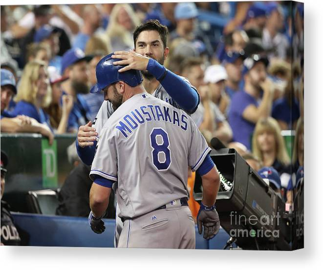 Three Quarter Length Canvas Print featuring the photograph Mike Moustakas And Eric Hosmer by Tom Szczerbowski