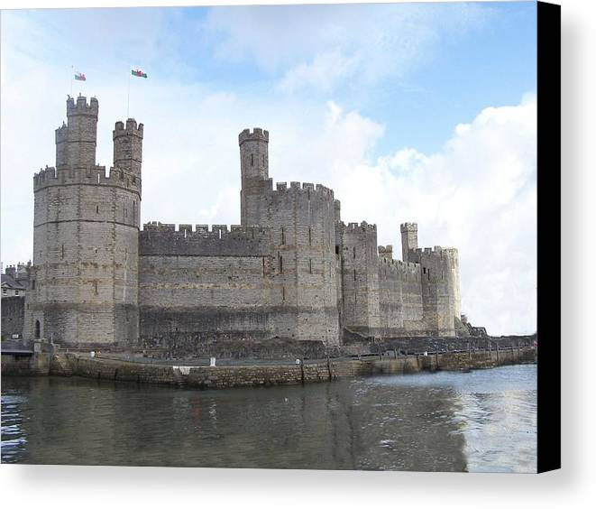 Castles Canvas Print featuring the photograph Caernarfon Castle by Christopher Rowlands