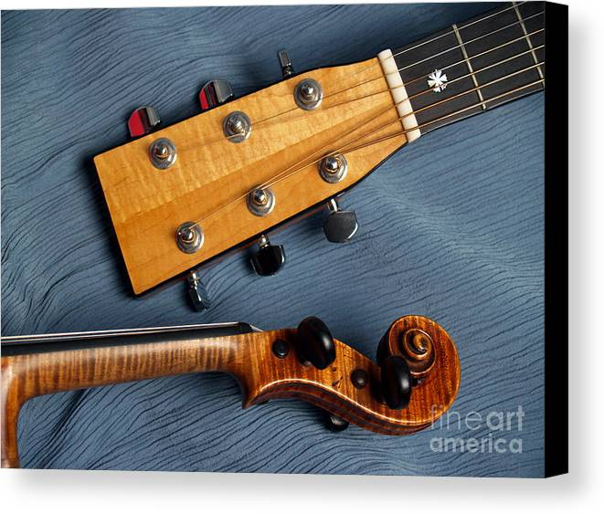 Guitar Canvas Print featuring the photograph Guitar And Violin Heads On Blue by Anna Lisa Yoder