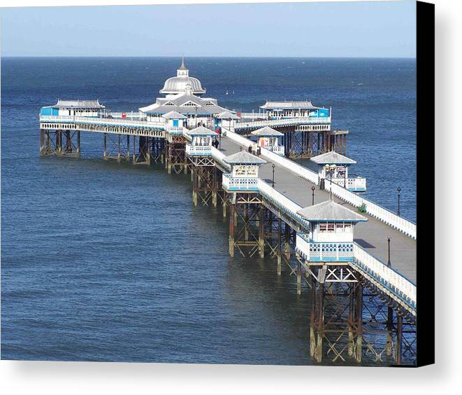 Piers Canvas Print featuring the photograph Llandudno Pier by Christopher Rowlands
