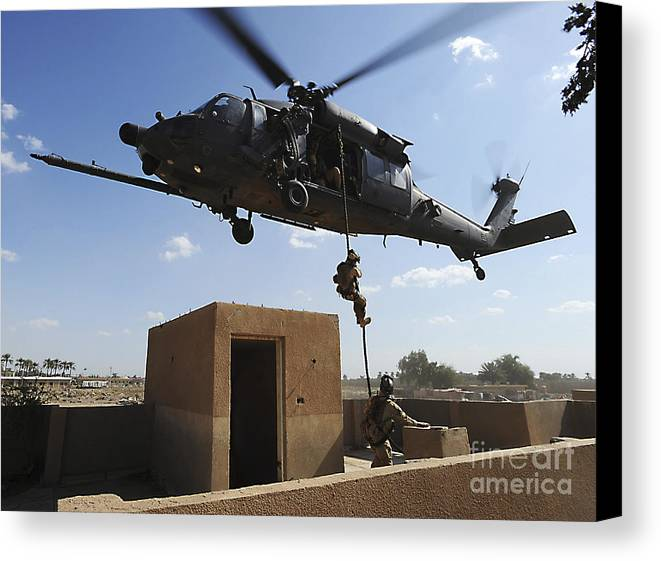 Pararescue Canvas Print featuring the photograph A U.s. Air Force Pararescuemen Fast by Stocktrek Images