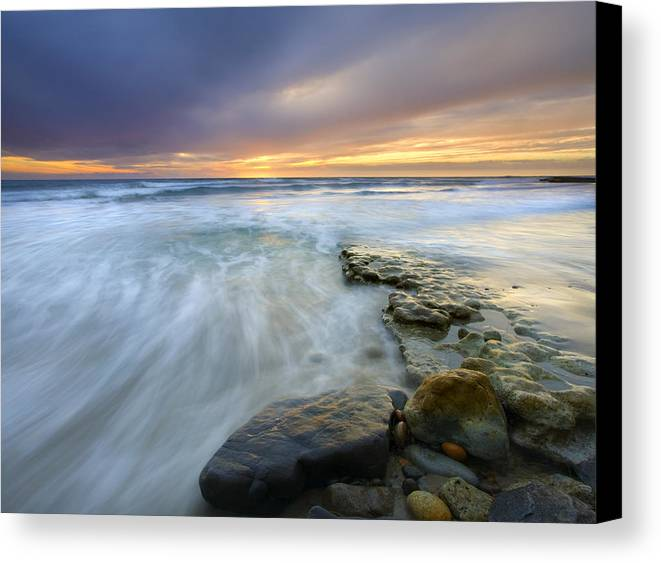Rocks Canvas Print featuring the photograph Driven Before The Storm by Mike Dawson