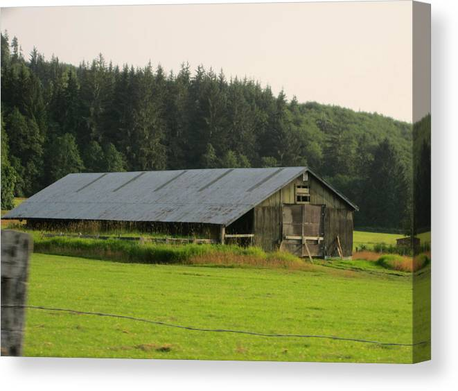 Nice Barn Canvas Print featuring the photograph Barn And Barbwire by Kym Backland