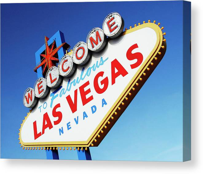 Risk Canvas Print featuring the photograph Welcome To Las Vegas Sign, Low Angle by Steven Puetzer