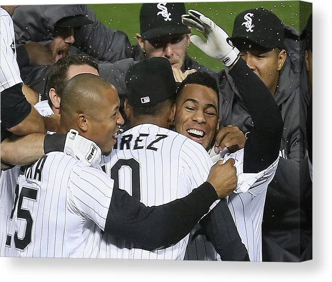 American League Baseball Canvas Print featuring the photograph Moises Sierra And Alexei Ramirez by Jonathan Daniel