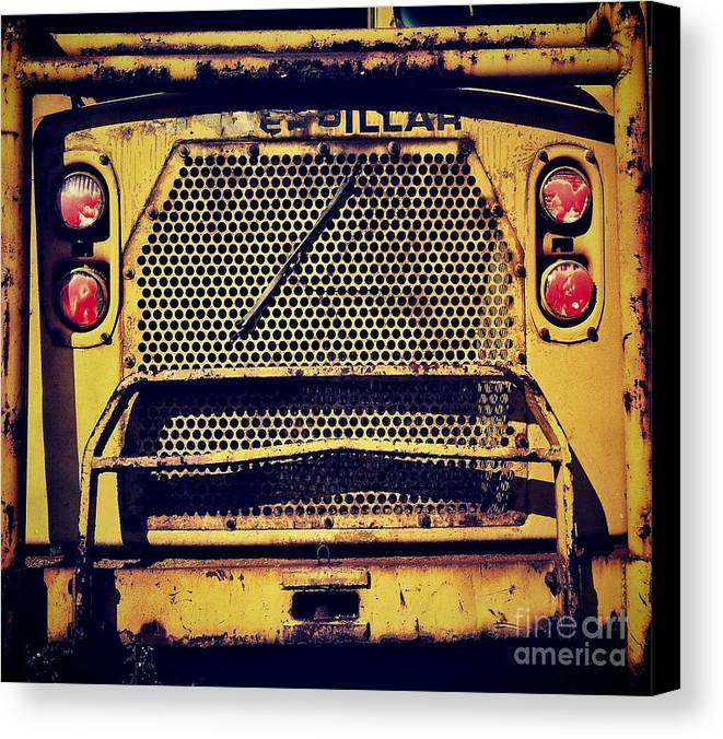 Caterpillar Canvas Print featuring the photograph Dump Truck Grille by Amy Cicconi