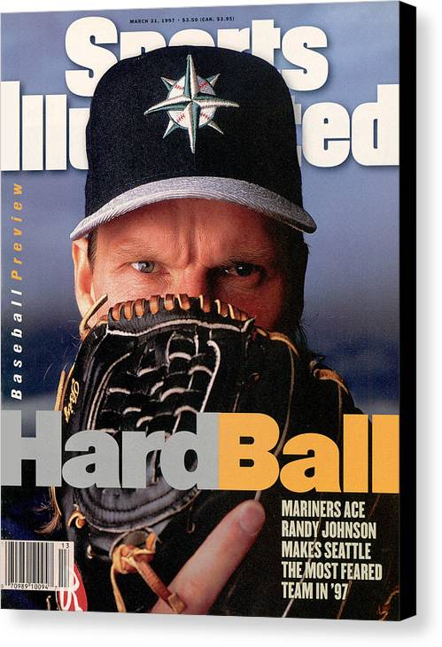 Magazine Cover Canvas Print featuring the photograph Seattle Mariners Randy Johnson, 1997 Mlb Baseball Preview Sports Illustrated Cover by Sports Illustrated