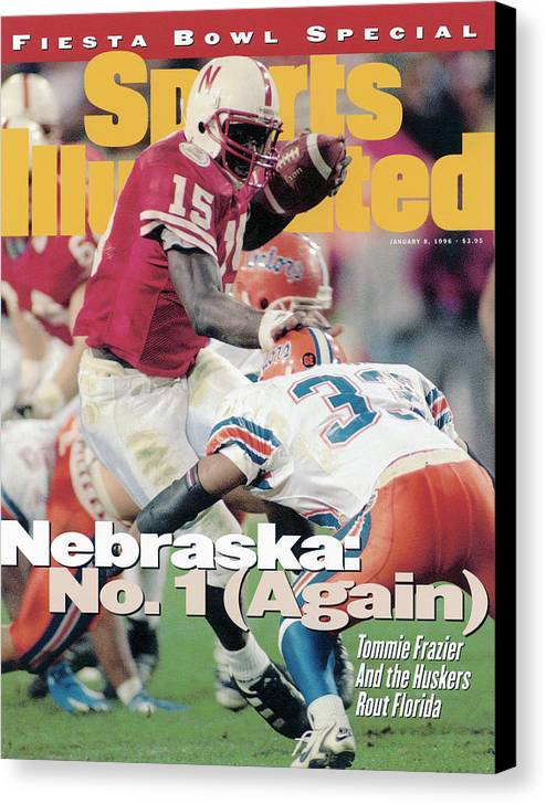 Celebration Canvas Print featuring the photograph University Of Nebraska Qb Tommie Frazier, 1996 Tostitos Sports Illustrated Cover by Sports Illustrated