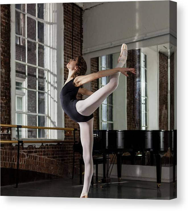 Ballet Dancer Canvas Print featuring the photograph Ballerina Performing Attitude In Dance by Nisian Hughes