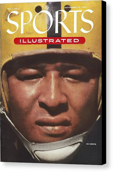 1950-1959 Canvas Print featuring the photograph University Of Iowa Calvin Jones Sports Illustrated Cover by Sports Illustrated