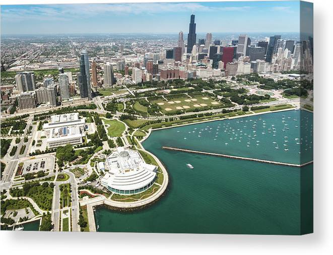 Downtown District Canvas Print featuring the photograph Aerial View Of The Downtown In Chicago by Franckreporter